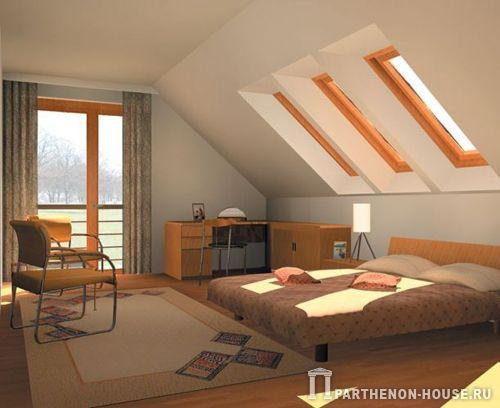 Эта спальня в мансарде невелика по