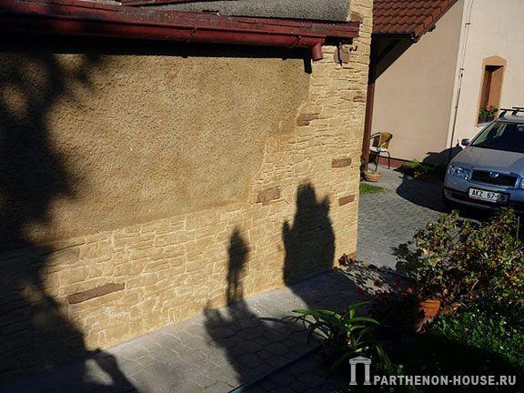 Отделка фасада дома штукатуркой